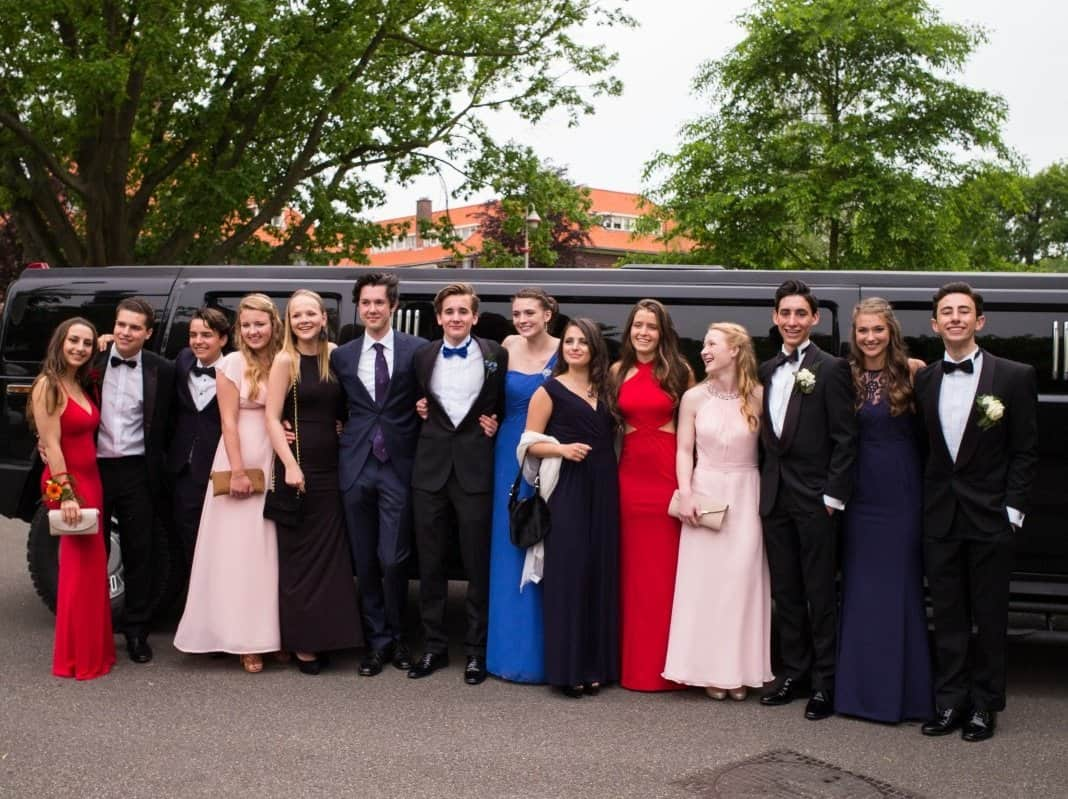 Prom Couples posing for a picture with Hummer Limo in Orlando