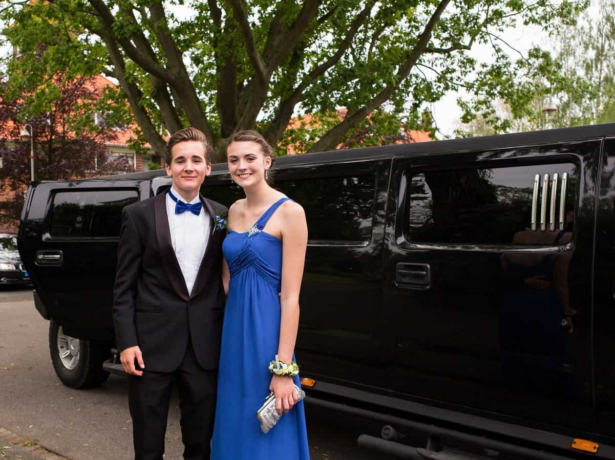 Beautiful couple outside a hummer limo for their Prom in Orlando