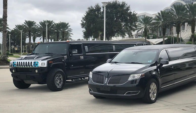 Stretch Limo Fleet parked outside the Convention Center