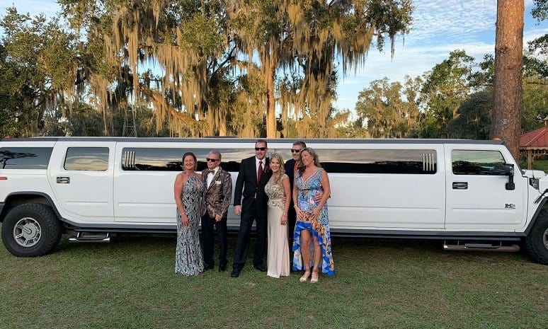 Couples ready to go to a concert outside the hummer limo