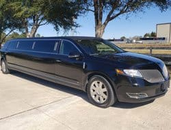A Front and Side View of a Black MKT Stretch Limo