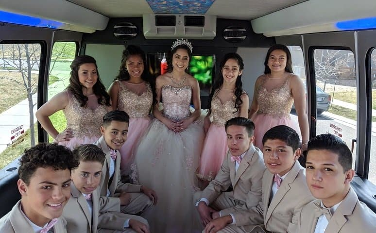 Boys and Girls dressed up in Quinceañera limo