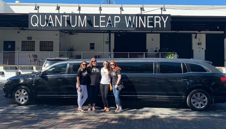 Friends with a black limo outside the Winery