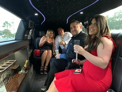Couples celebrating inside a MKT Limo with Champagne